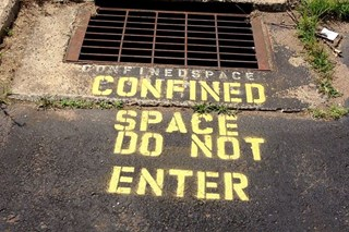 What types of gas should I watch out for when working in a confined space?