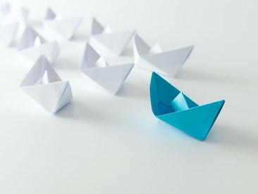 How can I motivate an organization to update its leadership beliefs?