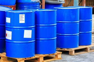 How do I store 55-gallon drums of hazardous chemicals?