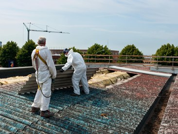 If I suspect potentially dangerous asbestos exposure is occurring in my workplace, who do I report it to?