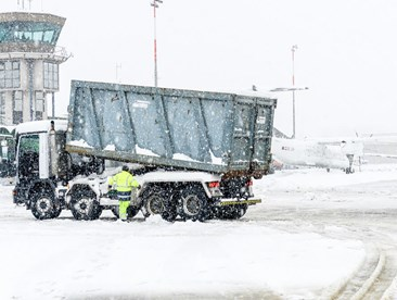 What dangers do workers face when working outside in the winter?
