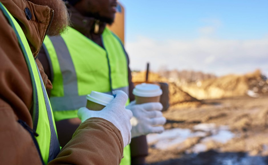 Workers drinking coffee outdoors