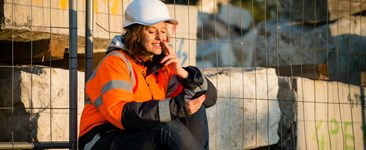 Worker looking at phone during smoke break