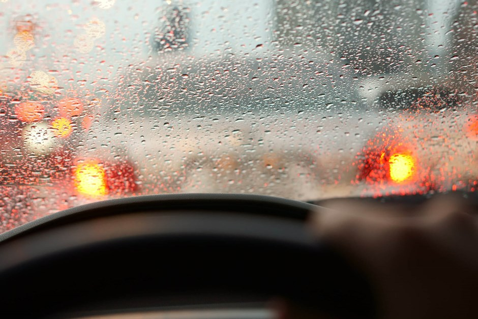 Driver at a standstill in rainy weather conditions