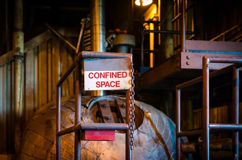 Confined spaces open the door to a host of associated hazards. Learn what a confined space is, and how to stay safe when working in one.