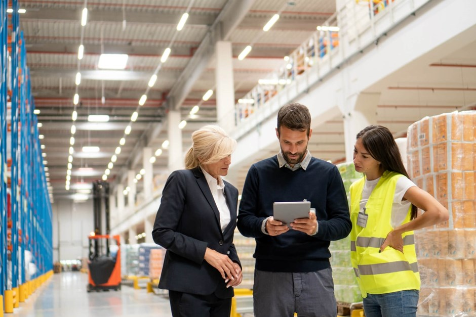 Safety professional and management in warehouse