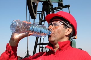 How does dehydration impact workplace safety?