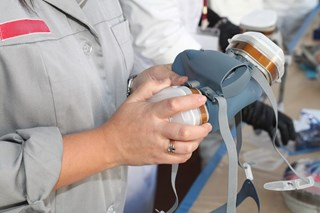 What are positive and negative pressure seal checks and how are they performed?
