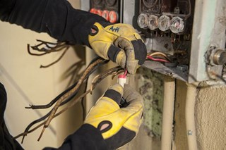 How much voltage protection is needed for safety gloves used in electrical work?