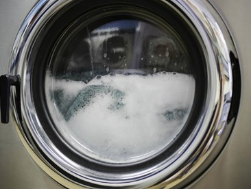 What detergent can you use to wash FR clothing?