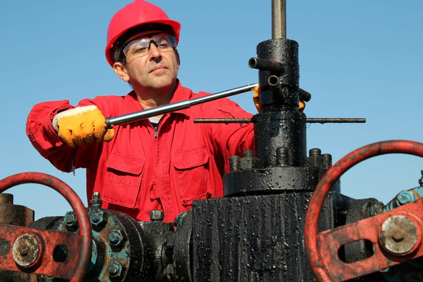 Oil worker with flame-resistant outfit