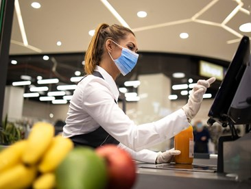 Grocery cashier with mask