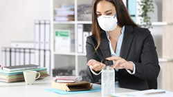 Workplace manager using hand sanitizer