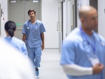 Healthcare workers walking and standing