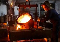 Foundry worker in heavy PPE