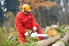 What kind of face protection do I need when using a chainsaw?