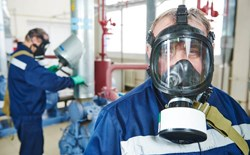 What PPE is needed when working with hydrogen sulfide (H2S)?