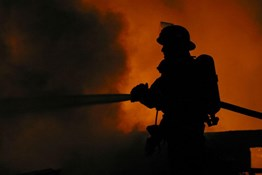 What are some of the risks firefighters face from asbestos exposure?
