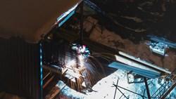 Welder working at night in winter