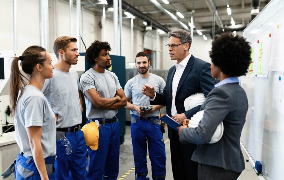 Manager delivering safety moment to workers