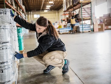 Worker in warehouse wearing safety shoes