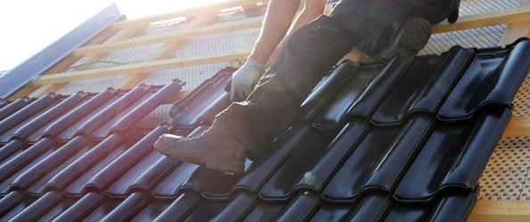 Roofer installing tiles