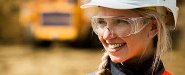Worker in hard hat, safety glasses, and hi-vis clothing