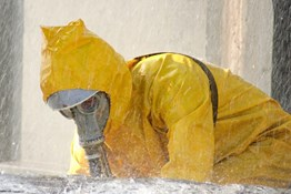 What should I look for in rainwear if I work with chemicals?