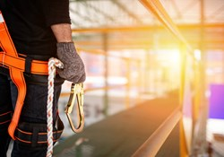 Worker at height in fall protection gear