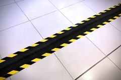 Yellow and black safety floor tape