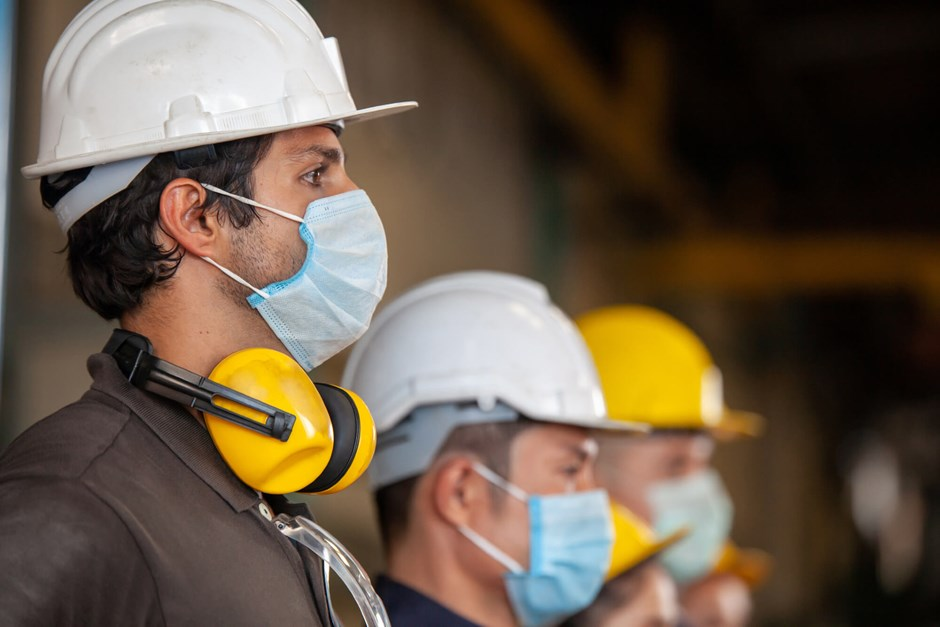 Workers wearing facemasks