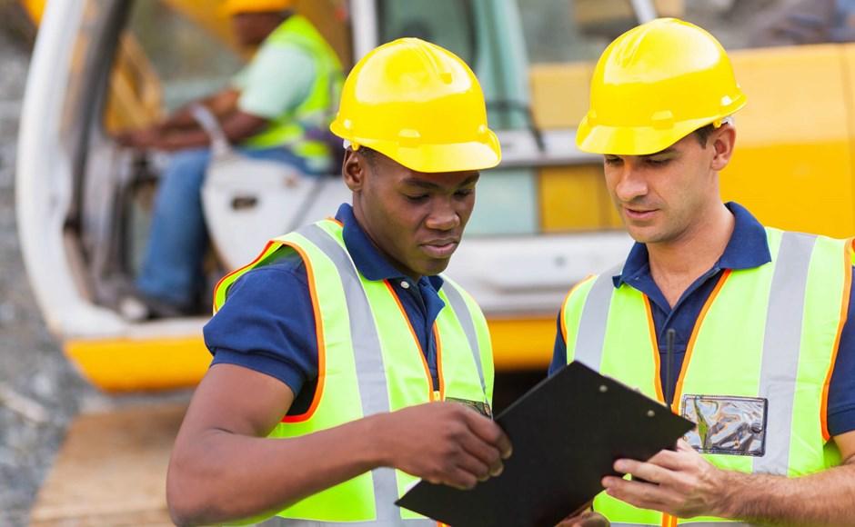 Workers in hi-vis vests
