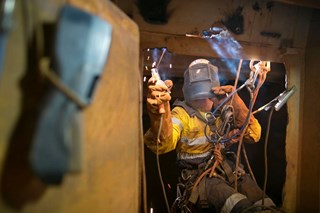 How can workers be protected from dehydration in confined spaces?