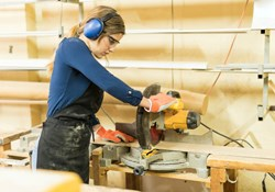 Worker using circular saw