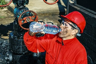 What is hyponatremia and when is it a risk in the workplace?