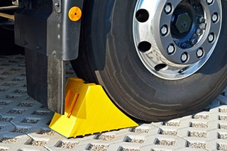 How many wheel chocks should be used at a loading dock?