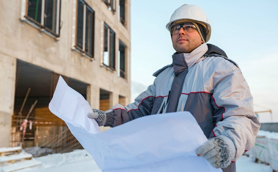 Civil engineer at a construction site in winter