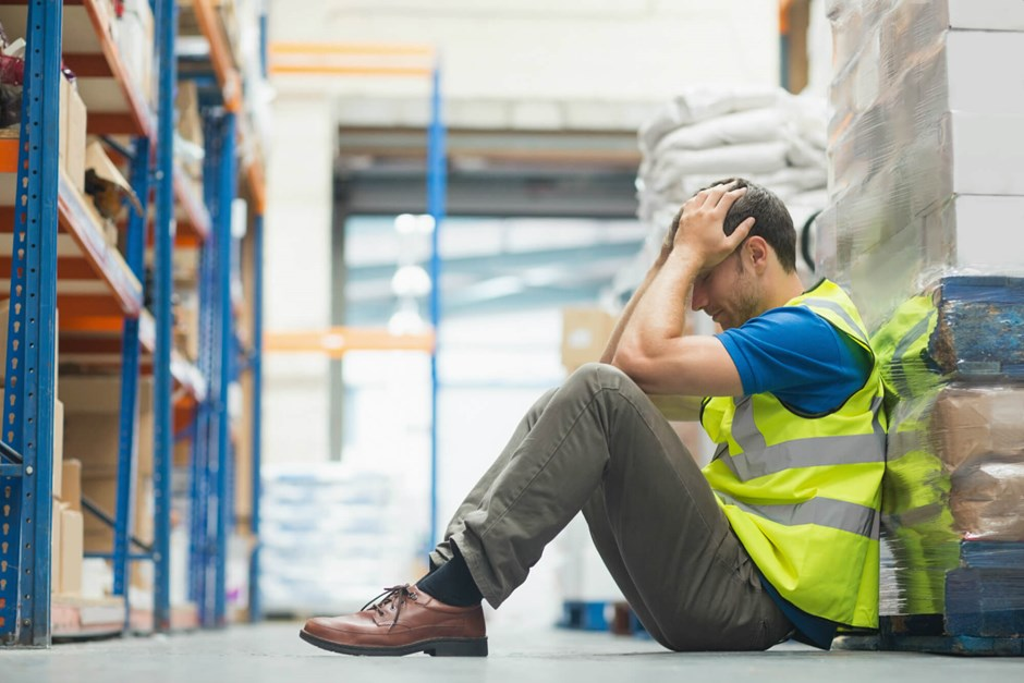Fatigued warehouse worker